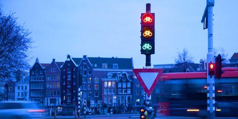 signaling device, Street, Signage, Sign, Electricity, Traffic light, Lane, Traffic sign, Pole, Public utility,