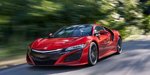 Automotive design, Mode of transport, Automotive mirror, Car, Automotive lighting, Red, Sports car, Supercar, Personal luxury car, Alloy wheel,