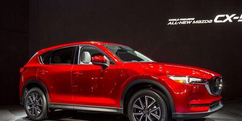 Tire, Wheel, Automotive design, Vehicle, Car, Automotive lighting, Red, Automotive tire, Alloy wheel, Fender,