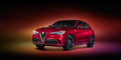 Automotive design, Mode of transport, Automotive lighting, Car, Red, Grille, Headlamp, Personal luxury car, Alloy wheel, Luxury vehicle,