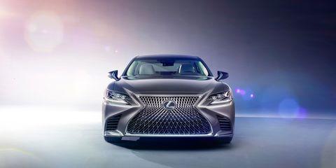 Automotive design, Product, Event, Vehicle, Headlamp, Grille, Car, Automotive lighting, Logo, Mid-size car,