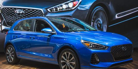 Wheel, Tire, Motor vehicle, Automotive design, Blue, Vehicle, Car, Land vehicle, Grille, Automotive lighting,