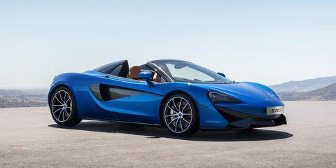 Tire, Wheel, Mode of transport, Automotive design, Blue, Vehicle, Rim, Vehicle door, Car, Supercar,