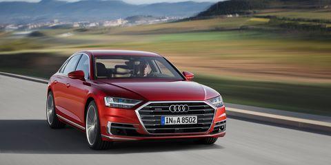 Automotive design, Vehicle, Grille, Car, Alloy wheel, Automotive mirror, Audi, Logo, Rim, Automotive lighting,