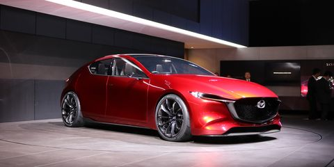 Land vehicle, Vehicle, Car, Mazda, Auto show, Automotive design, Red, Mid-size car, Mode of transport, Sports car,