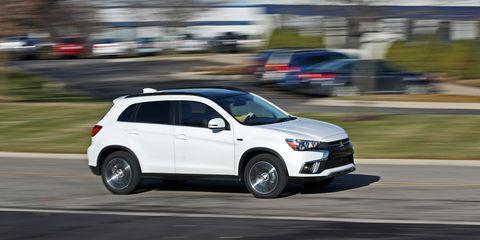 Land vehicle, Vehicle, Car, Mitsubishi, Sport utility vehicle, Automotive tire, Mid-size car, Mitsubishi outlander, Automotive design, Compact sport utility vehicle,
