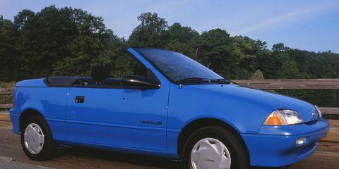Land vehicle, Vehicle, Car, Blue, Hood, Geo metro, Automotive design, City car, Electric blue, Coupé,