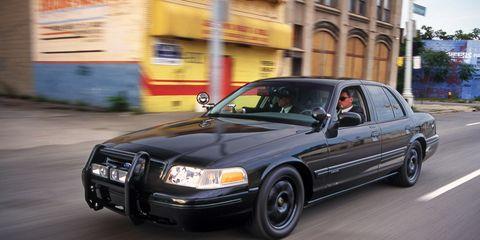 Land vehicle, Vehicle, Car, Ford crown victoria, Full-size car, Ford crown victoria police interceptor, Ford, Sedan, Automotive design, Luxury vehicle,