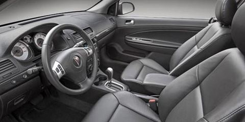 Motor vehicle, Mode of transport, Steering part, Automotive design, Vehicle, Steering wheel, Vehicle door, White, Car seat, Car,