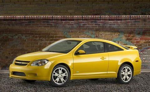 Tire, Wheel, Motor vehicle, Automotive mirror, Automotive design, Yellow, Vehicle, Brick, Alloy wheel, Rim,
