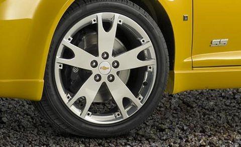Tire, Wheel, Motor vehicle, Automotive tire, Alloy wheel, Automotive wheel system, Yellow, Automotive design, Vehicle, Rim,
