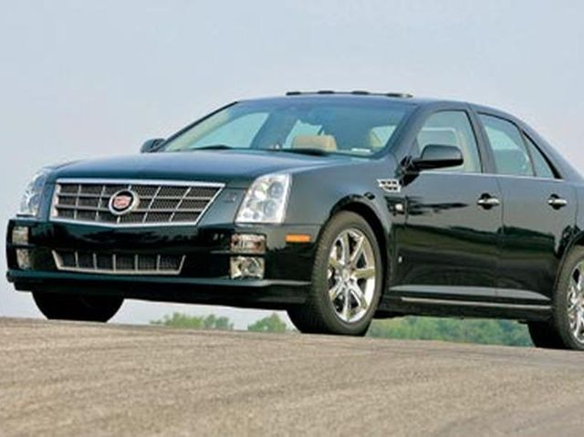 Cadillac Sts Review Pricing And Specs