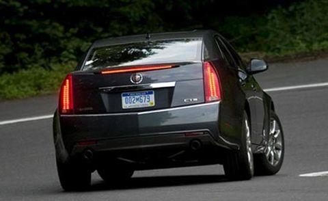 Motor vehicle, Mode of transport, Automotive tail & brake light, Road, Automotive design, Vehicle, Land vehicle, Automotive lighting, Vehicle registration plate, Road surface,