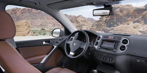 Motor vehicle, Automotive mirror, Mode of transport, Steering part, Steering wheel, Vehicle door, White, Car, Glass, Car seat,
