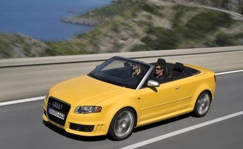 Tire, Motor vehicle, Wheel, Mode of transport, Automotive design, Road, Vehicle, Transport, Yellow, Automotive mirror,