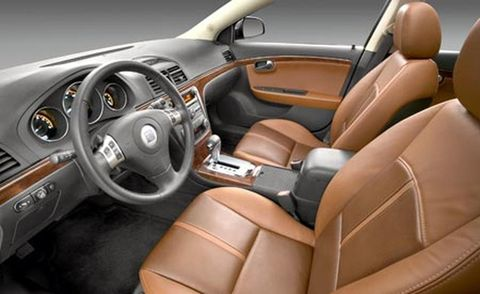 Motor vehicle, Steering part, Mode of transport, Brown, Vehicle, Product, Steering wheel, Automotive design, Car seat, Center console,