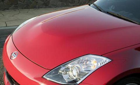 Automotive design, Vehicle, Automotive lighting, Hood, Headlamp, Land vehicle, Car, Automotive exterior, Red, Automotive parking light,