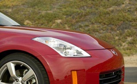 Tire, Automotive design, Vehicle, Automotive lighting, Hood, Headlamp, Land vehicle, Car, Red, Automotive mirror,