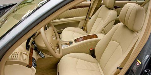 Motor vehicle, Mode of transport, Vehicle, Car seat, Vehicle door, Car seat cover, Head restraint, Luxury vehicle, Steering wheel, Seat belt,