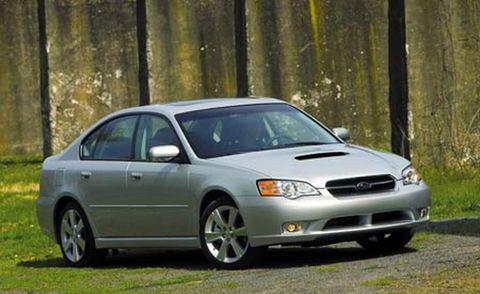Tire, Daytime, Vehicle, Glass, Rim, Infrastructure, Car, Headlamp, Hood, Full-size car,