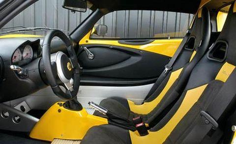Motor vehicle, Mode of transport, Automotive design, Yellow, Vehicle, Automotive mirror, Vehicle door, Steering wheel, Steering part, Car seat,