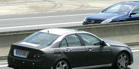 Tire, Motor vehicle, Wheel, Mode of transport, Vehicle, Road, Land vehicle, Alloy wheel, Automotive tire, Car,