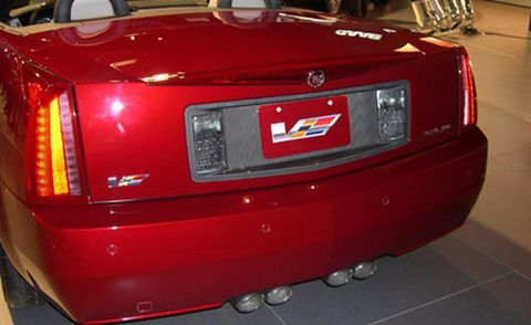 Motor vehicle, Automotive tail & brake light, Automotive design, Vehicle, Automotive exterior, Automotive lighting, Red, Car, Trunk, Automotive parking light,