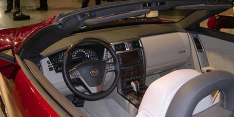 Motor vehicle, Mode of transport, Steering part, Steering wheel, Automotive design, Personal luxury car, Luxury vehicle, Center console, Classic car, Classic,