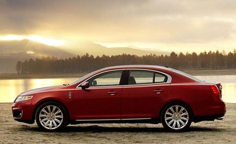 Tire, Wheel, Vehicle, Automotive design, Alloy wheel, Rim, Car, Full-size car, Red, Automotive tire,
