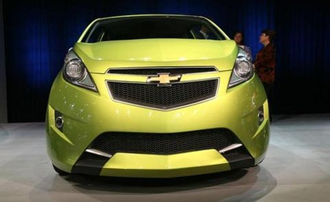 Motor vehicle, Automotive design, Daytime, Yellow, Vehicle, Grille, Car, Automotive lighting, Bumper, Light,