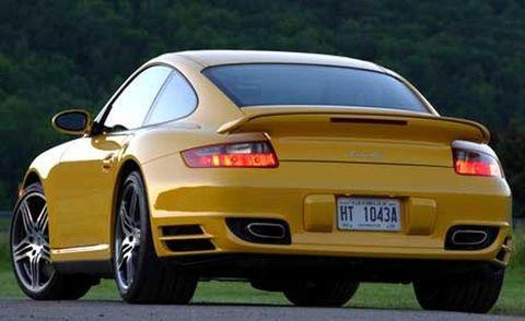 Tire, Wheel, Mode of transport, Automotive design, Vehicle registration plate, Vehicle, Automotive tail & brake light, Yellow, Automotive lighting, Land vehicle,