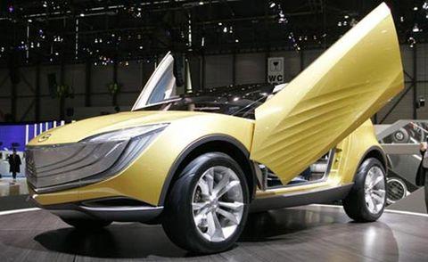 Motor vehicle, Wheel, Mode of transport, Automotive design, Yellow, Transport, Vehicle, Land vehicle, Car, Rim,