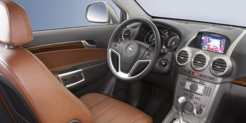 Motor vehicle, Steering part, Mode of transport, Product, Steering wheel, Brown, Automotive design, Automotive mirror, Transport, Center console,