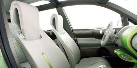 Motor vehicle, Mode of transport, Automotive design, Green, Yellow, Vehicle, Transport, White, Steering part, Steering wheel,