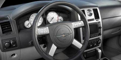 Motor vehicle, Steering part, Mode of transport, Transport, Steering wheel, White, Speedometer, Gauge, Center console, Black,