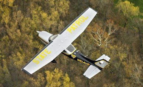 Airplane, Aircraft, Yellow, Model aircraft, Light aircraft, Propeller-driven aircraft, Air travel, Aviation, Wing, Aerospace engineering,