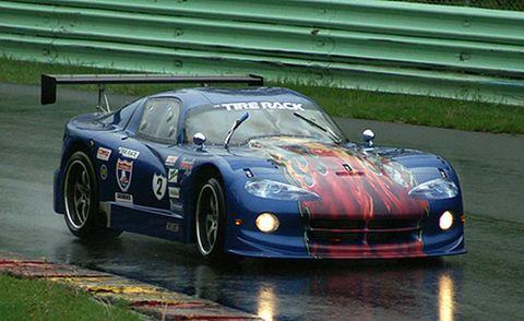 Tire, Automotive design, Vehicle, Hood, Performance car, Sports car racing, Car, Motorsport, Rallying, Sports car,