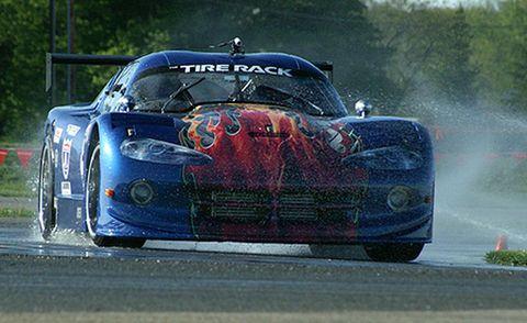 Tire, Automotive design, Vehicle, Sports car racing, Motorsport, Race track, Hood, Headlamp, Car, Rallying,