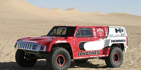 Tire, Wheel, Motor vehicle, Automotive tire, Sand, Automotive design, Automotive exterior, Natural environment, Aeolian landform, Automotive wheel system,
