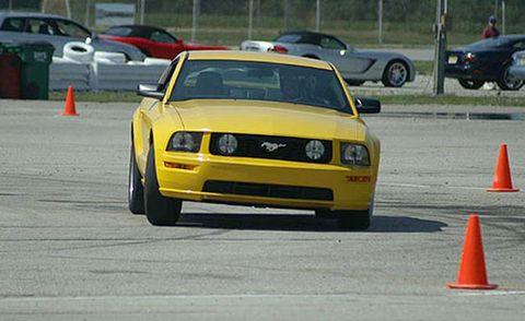 Tire, Vehicle, Land vehicle, Cone, Automotive design, Car, Asphalt, Road surface, Hood, Automotive exterior,