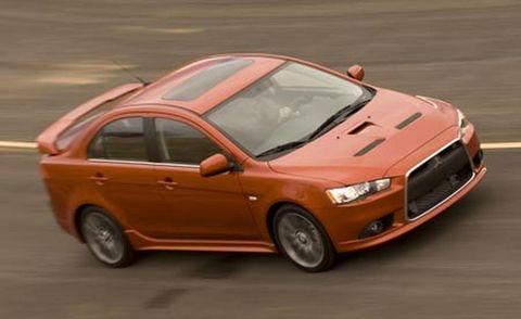 Automotive design, Vehicle, Automotive mirror, Land vehicle, Car, Alloy wheel, Hood, Rim, Red, Automotive tire,