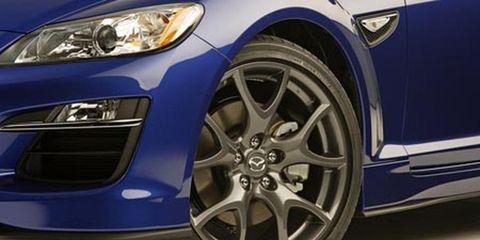 Tire, Automotive design, Blue, Daytime, Alloy wheel, Vehicle, Automotive wheel system, Automotive tire, Land vehicle, Rim,