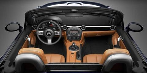 Motor vehicle, Mode of transport, Steering part, Automotive design, Steering wheel, Center console, Car seat, Personal luxury car, Luxury vehicle, Convertible,