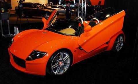 Tire, Automotive design, Vehicle, Performance car, Vehicle door, Personal luxury car, Fender, Supercar, Auto show, Alloy wheel,
