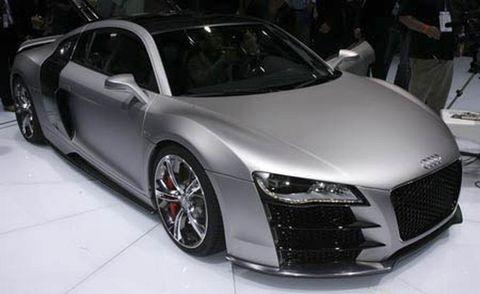 Automotive design, Vehicle, Event, Land vehicle, Car, Rim, White, Concept car, Personal luxury car, Alloy wheel,