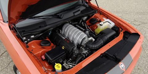 Automotive design, Engine, Orange, Automotive exterior, Hood, Automotive engine part, Vehicle door, Bumper, City car, Automotive air manifold,
