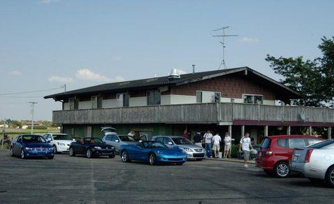 Land vehicle, Vehicle, Automotive parking light, Transport, Car, Pole, Hatchback, City car, Parking, Mid-size car,