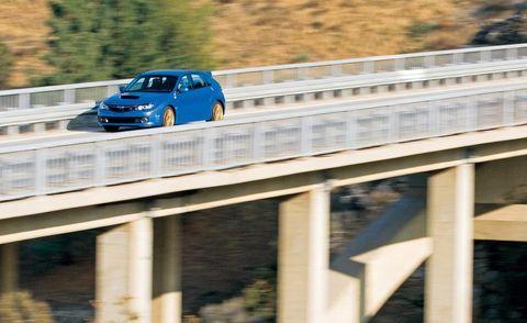 Automotive design, Vehicle, Automotive exterior, Transport, Car, Alloy wheel, Motorsport, Automotive mirror, Guard rail, Bridge,