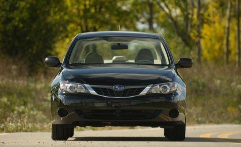 Automotive design, Vehicle, Road, Automotive mirror, Headlamp, Automotive lighting, Grille, Car, Glass, Automotive exterior,