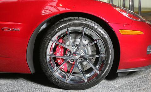 Tire, Wheel, Automotive design, Automotive tire, Alloy wheel, Vehicle, Automotive wheel system, Rim, Automotive exterior, Red,
